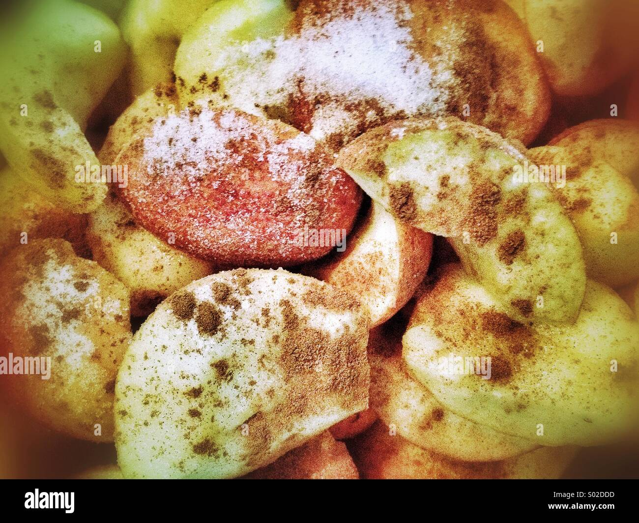 Apples with sugar and cinnamon, making cider - Stock Image