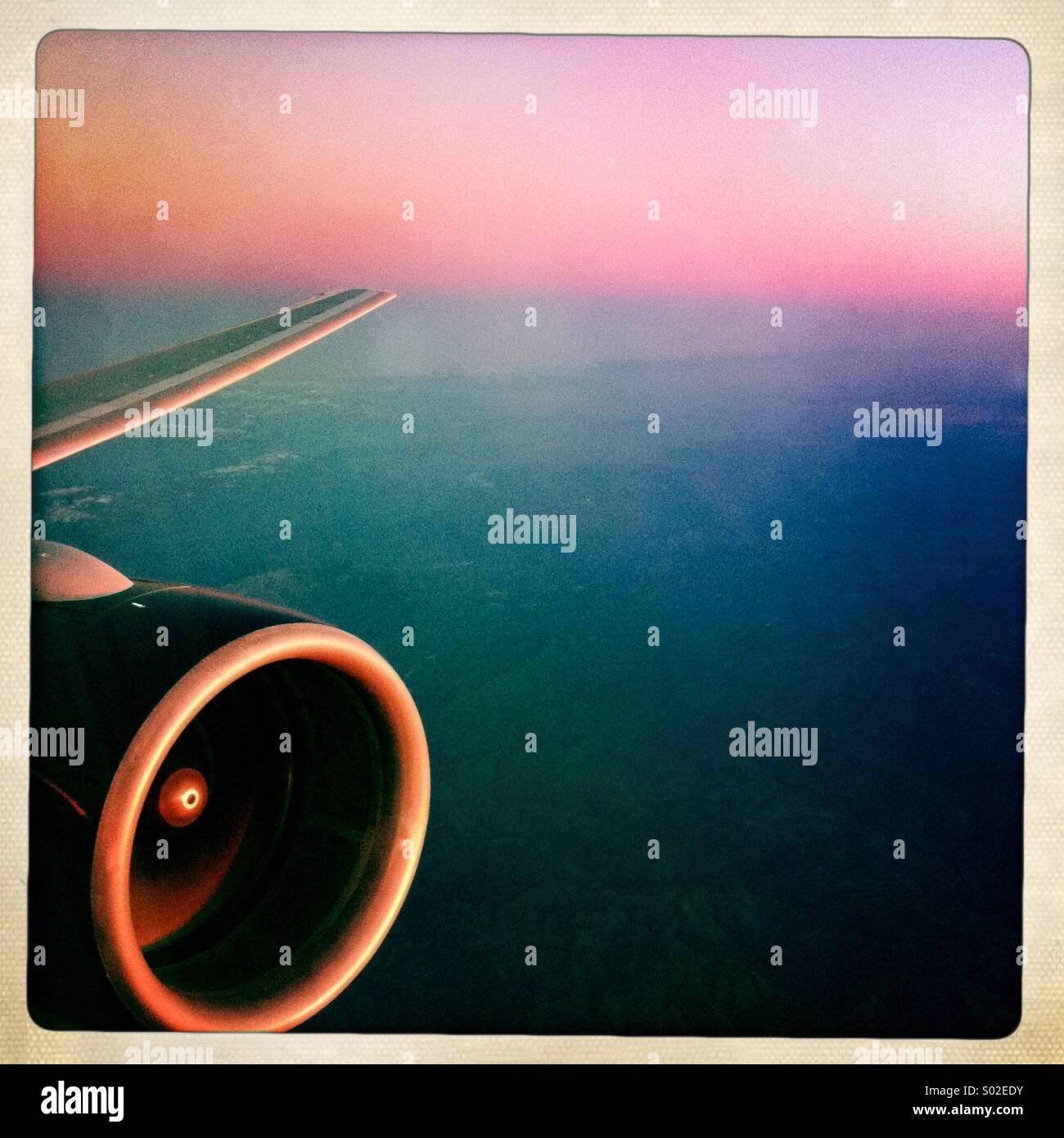 Sunset at 35,000 feet. - Stock Image