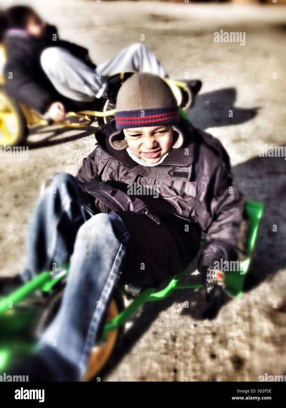 Mixed race boy smiling and playing outdoors. - Stock Image
