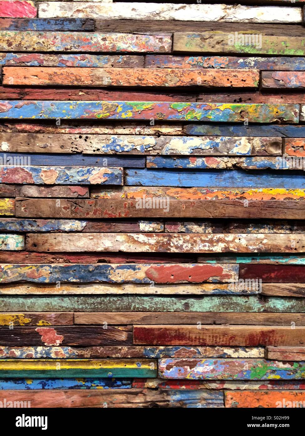 Repurposed Window Frames (vertical) now used as wall art. Reclaimed wood wall. - Stock Image