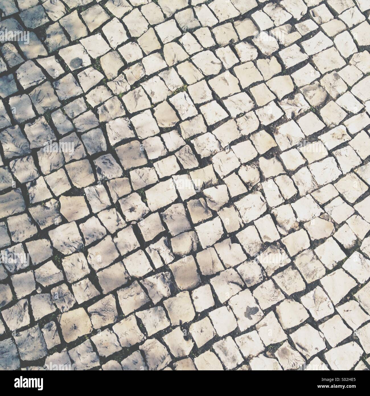 Typical Portuguese street pavement, cobbled stones. - Stock Image