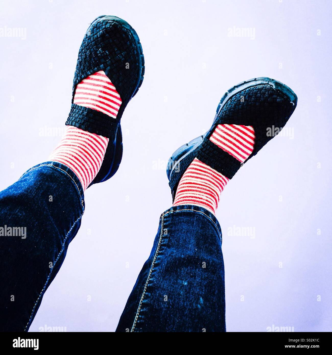 Feet in the air - Stock Image