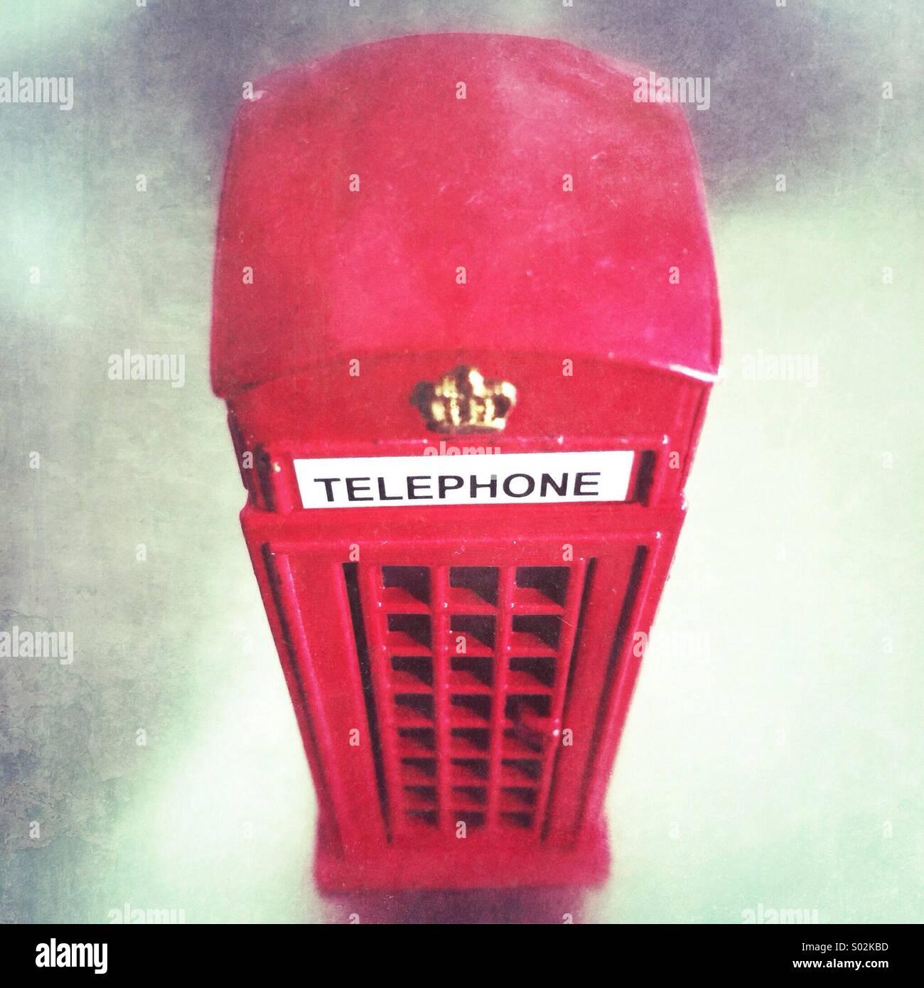 Toy telephone kiosk - Stock Image