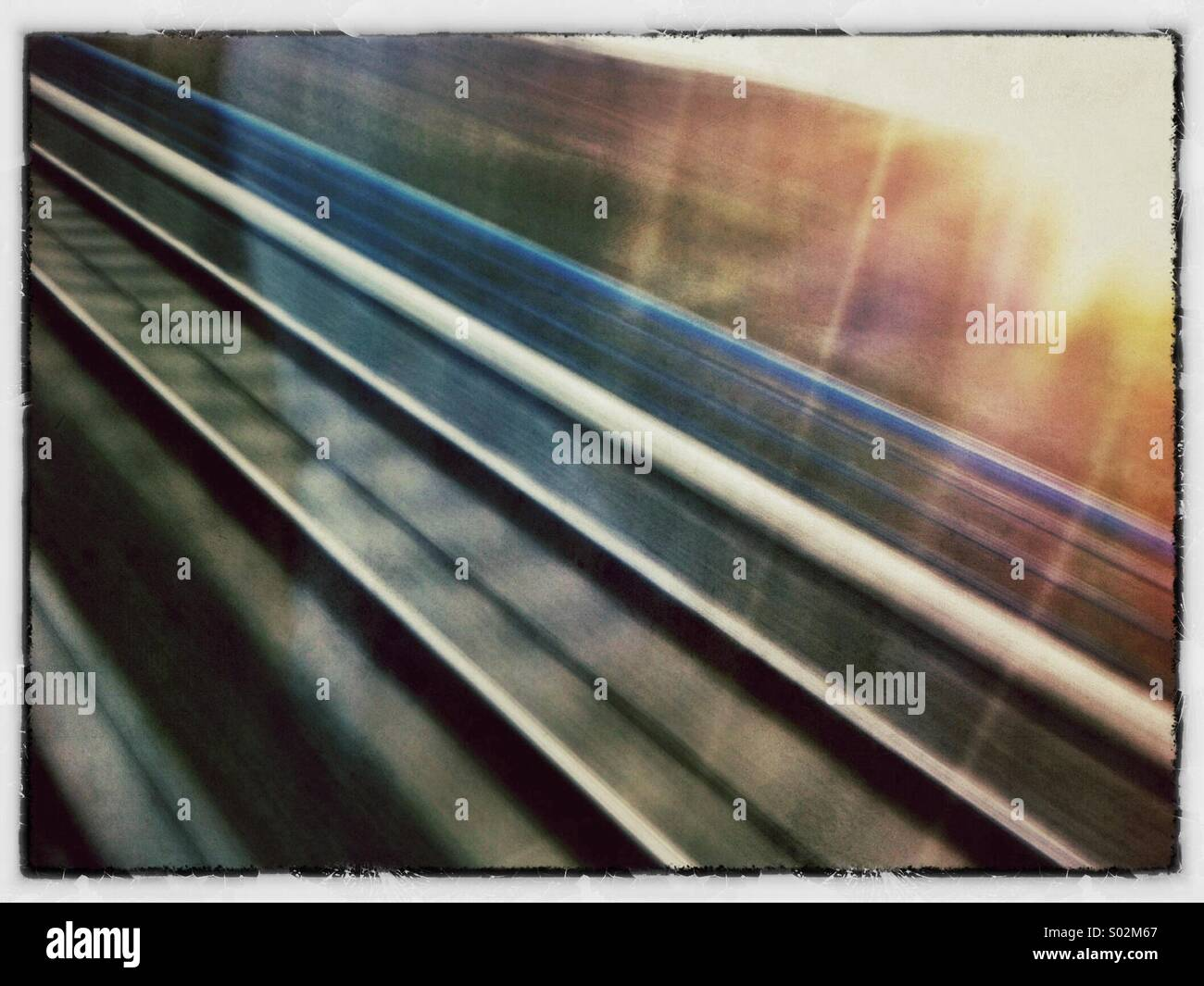 Railroad tracks from a moving train - Stock Image