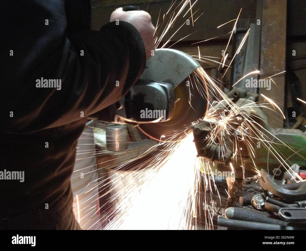Using an angle grinder - Stock Image