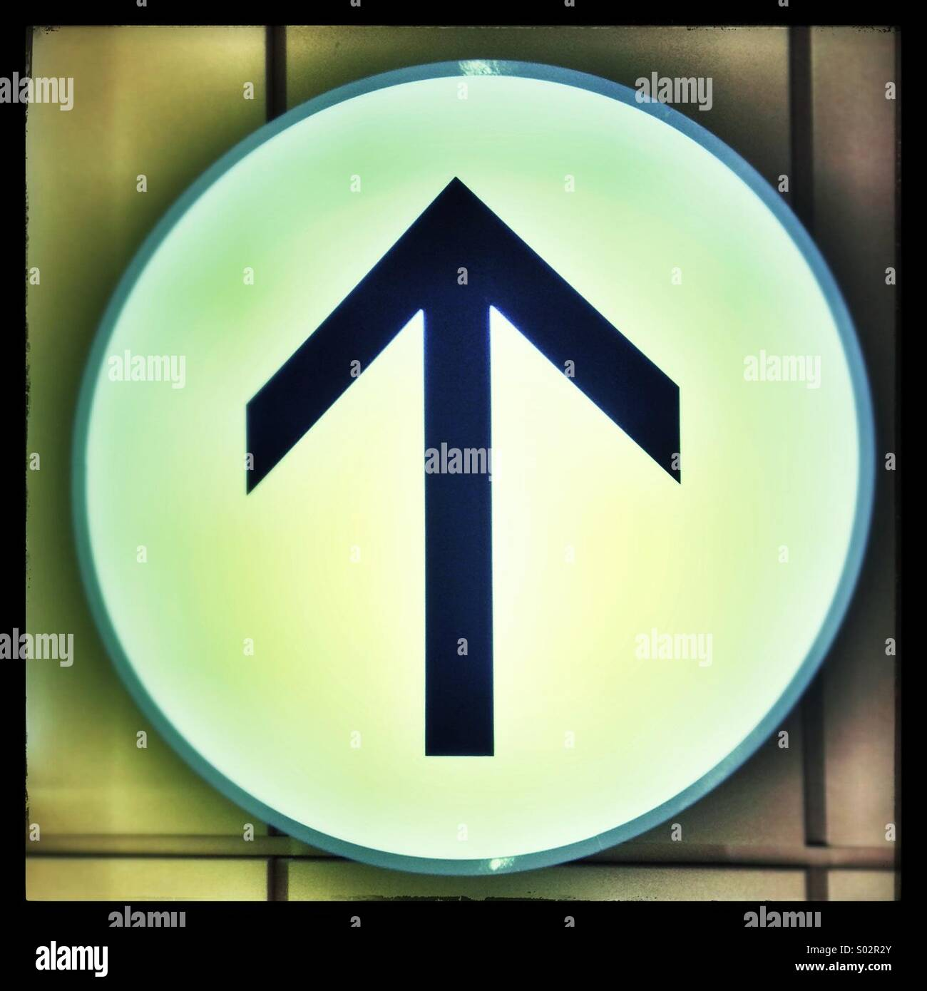 Arrow sign pointing upwards - Stock Image