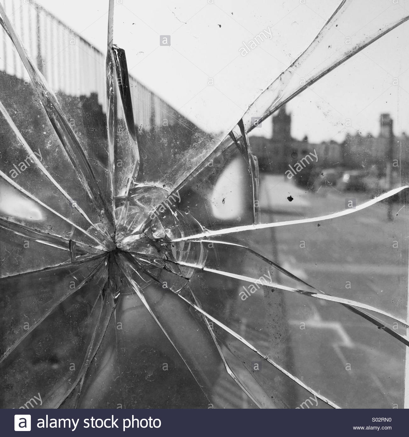 Cracked Glass in a Window Pane - Stock Image