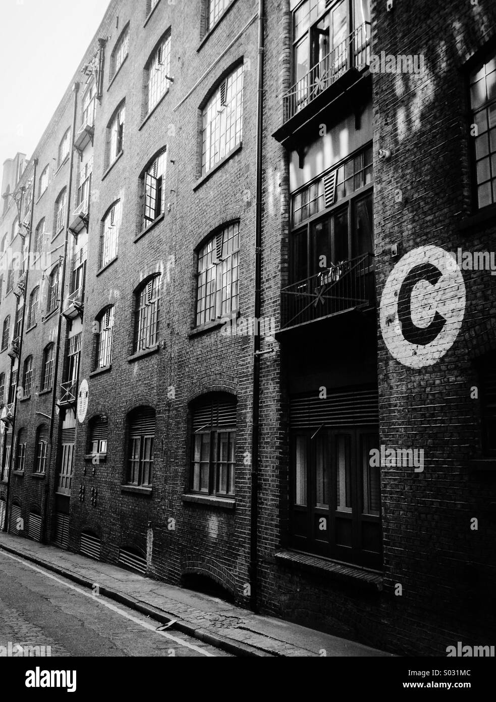 Victorian London docklands warehouse, now flats - Stock Image