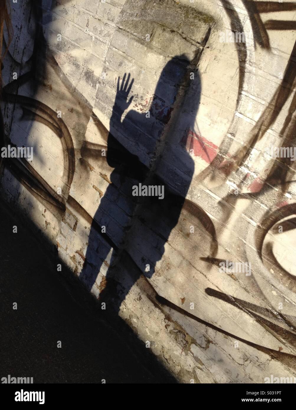 Shadow waving on wall - Stock Image