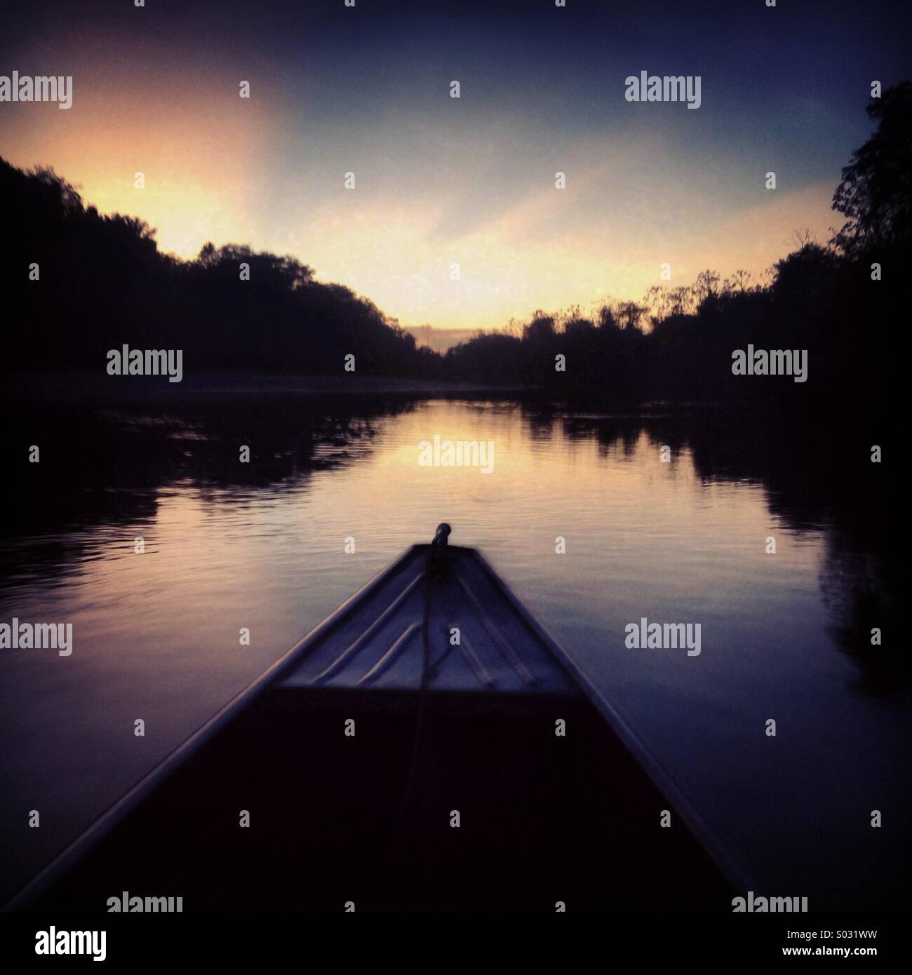 Canoe at dusk, Rupununi River, Guyana, South America - Stock Image