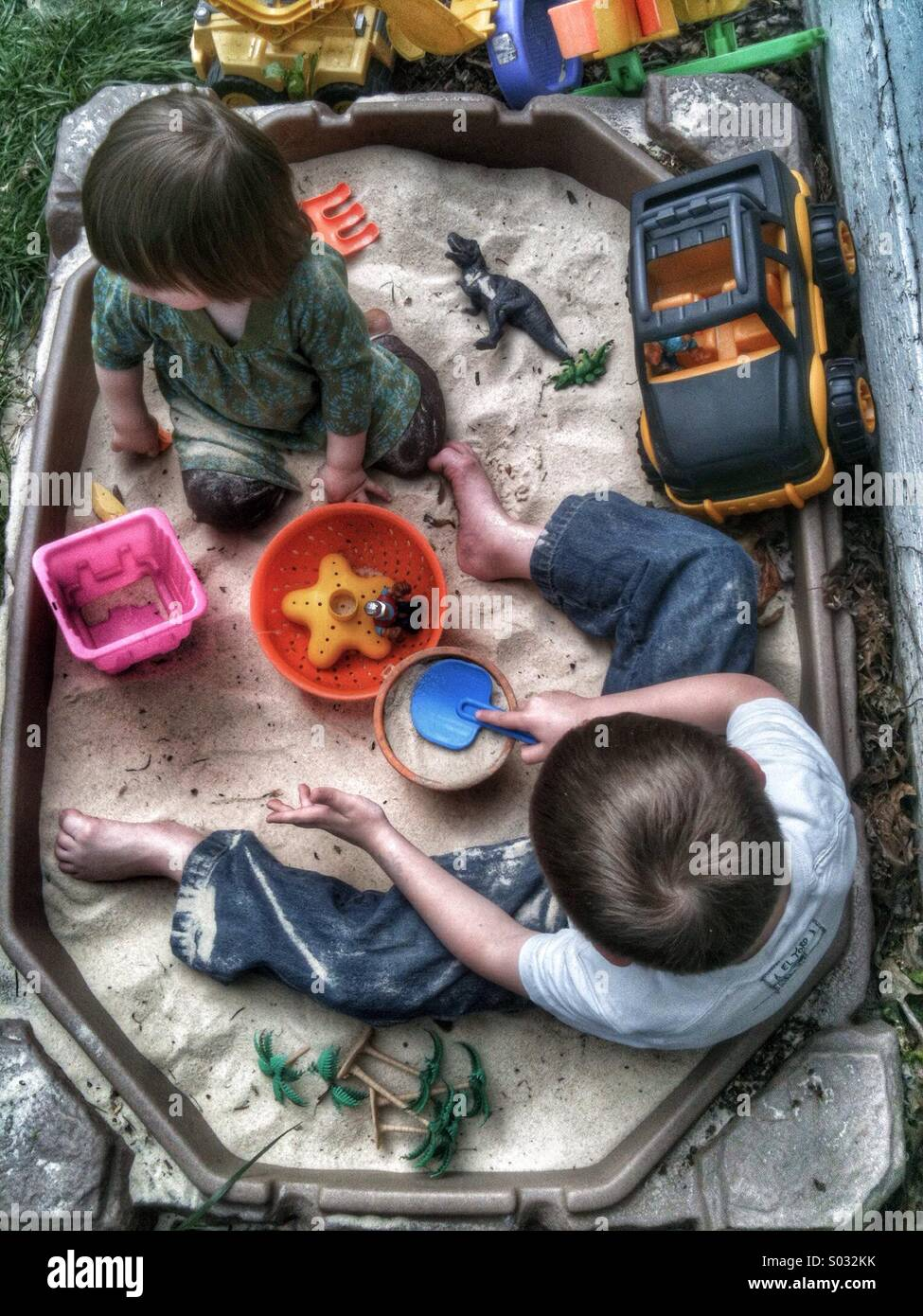 Kids in sandbox in the summer - Stock Image
