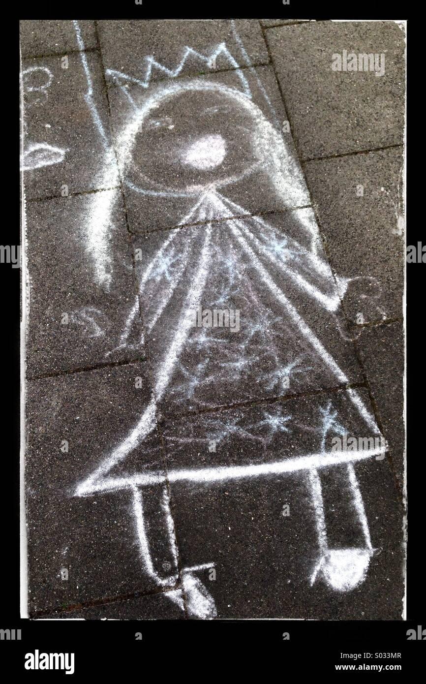 Chalk drawing of a Princess on a pavement - Stock Image