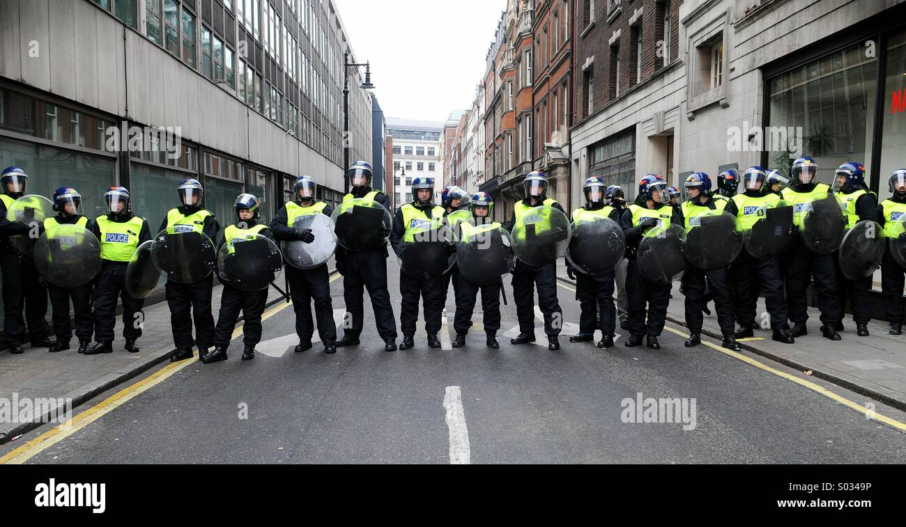 Police line the streets in London during a rally opposing public sector cuts, led by the coalition 'March for the Stock Photo