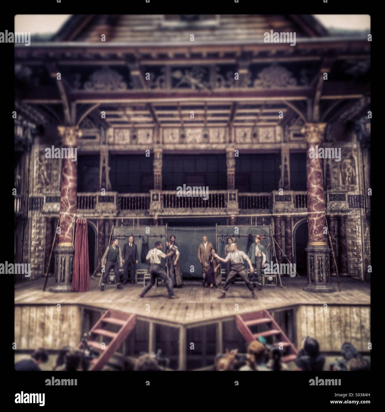 People perform a play on stage at the globe theatre in London - Stock Image