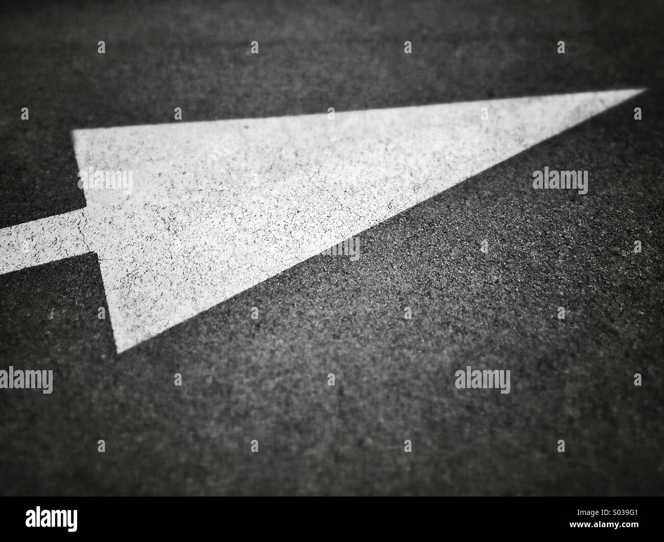 Arrow sign on asphalt Stock Photo