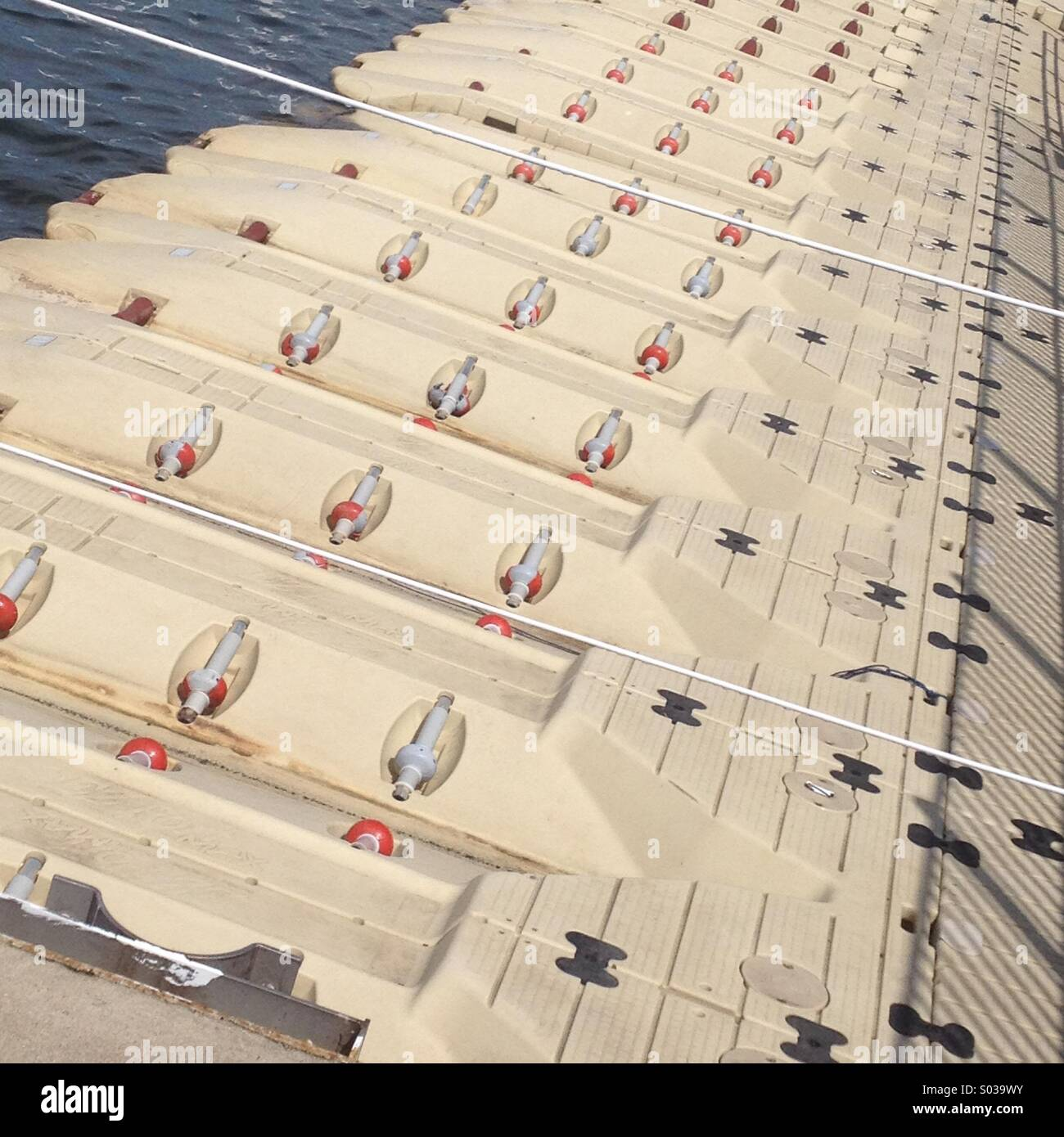 Marina symmetry : Long concrete dock for jet skis - Stock Image