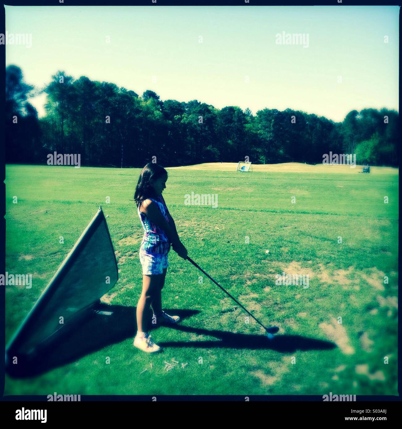 Little girl golfer - Stock Image