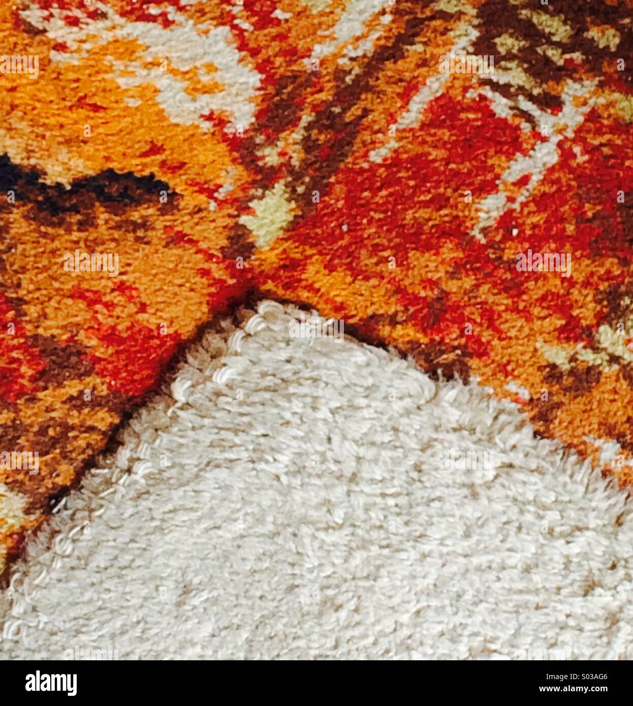 1970's colourful carpet patterns and white shag pile rug - Stock Image