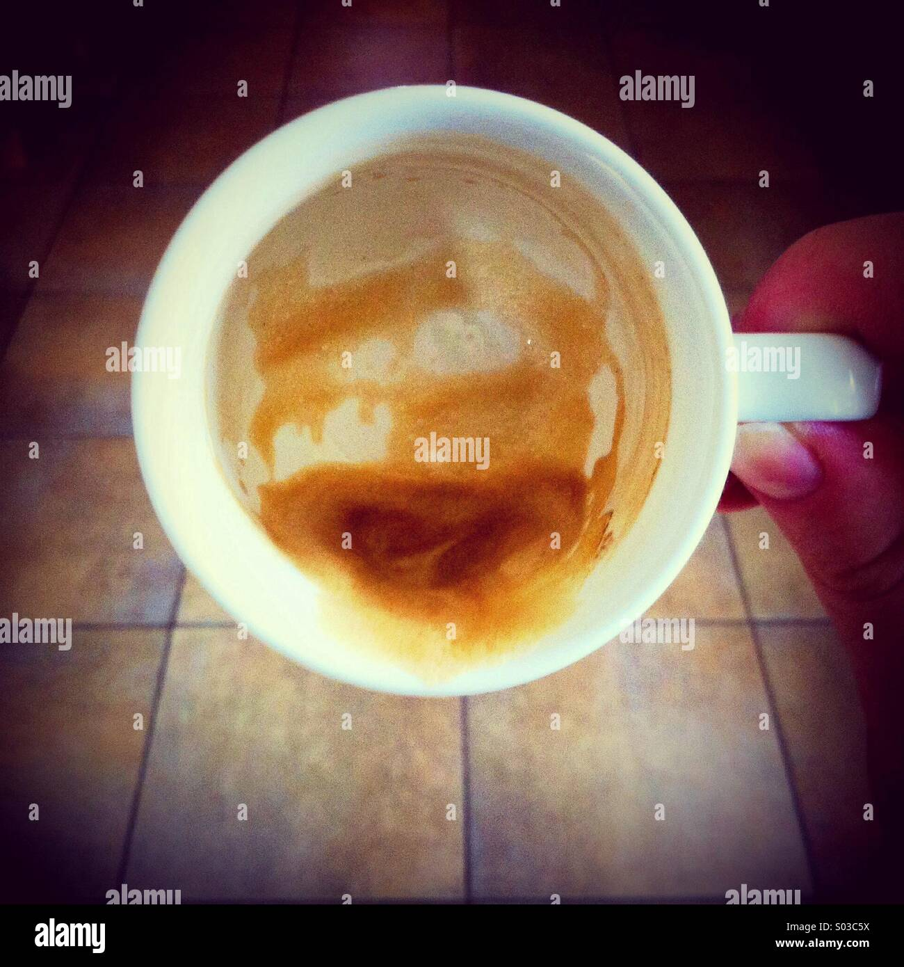 Last dregs of coffee from an espresso cup - Stock Image