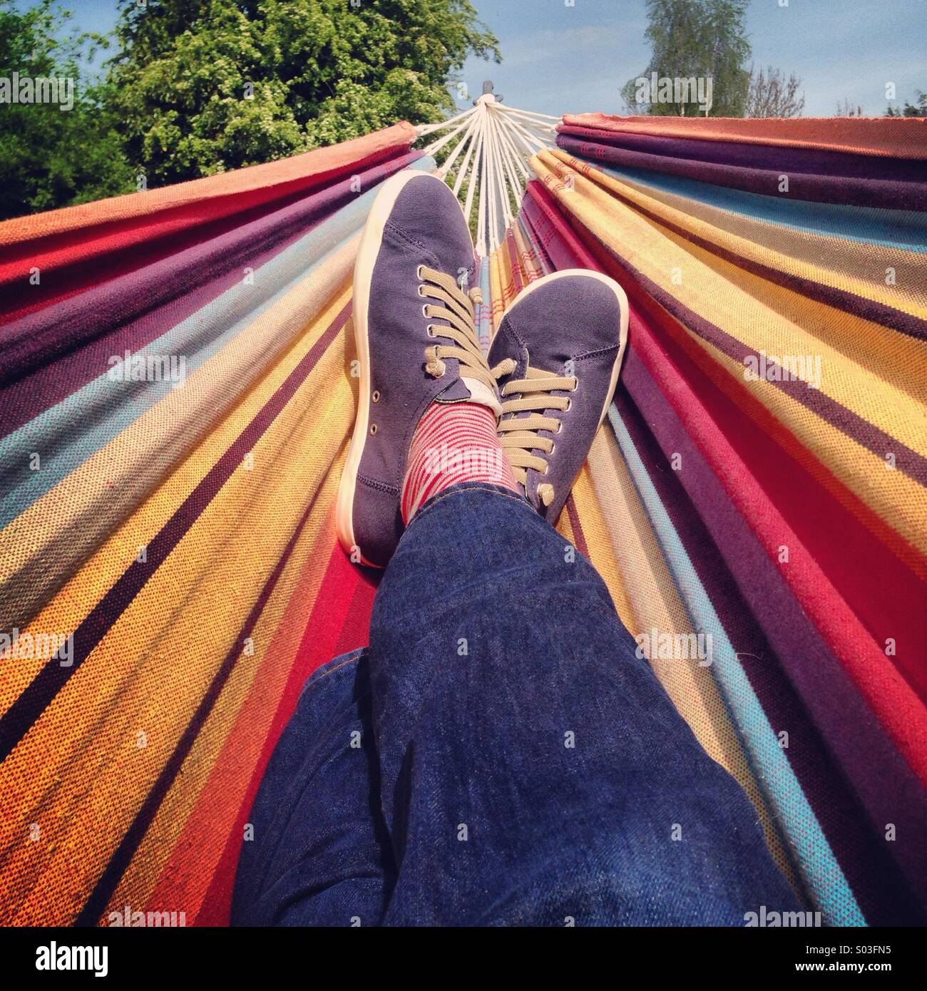 British Summertime arrives and lazy hammock days are afoot - Stock Image