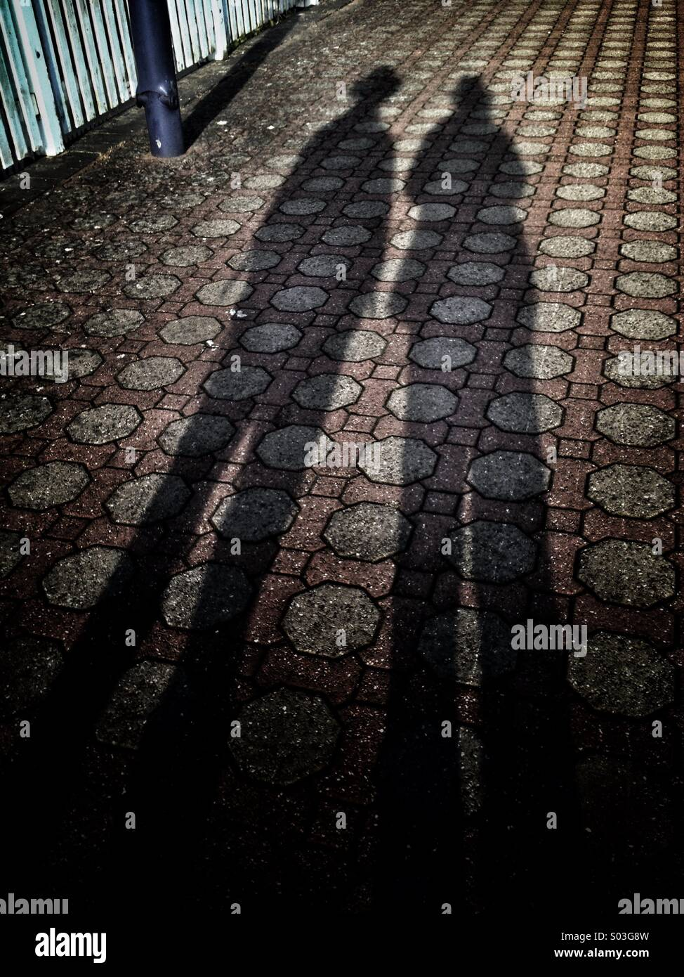 Shadowy pair - Stock Image