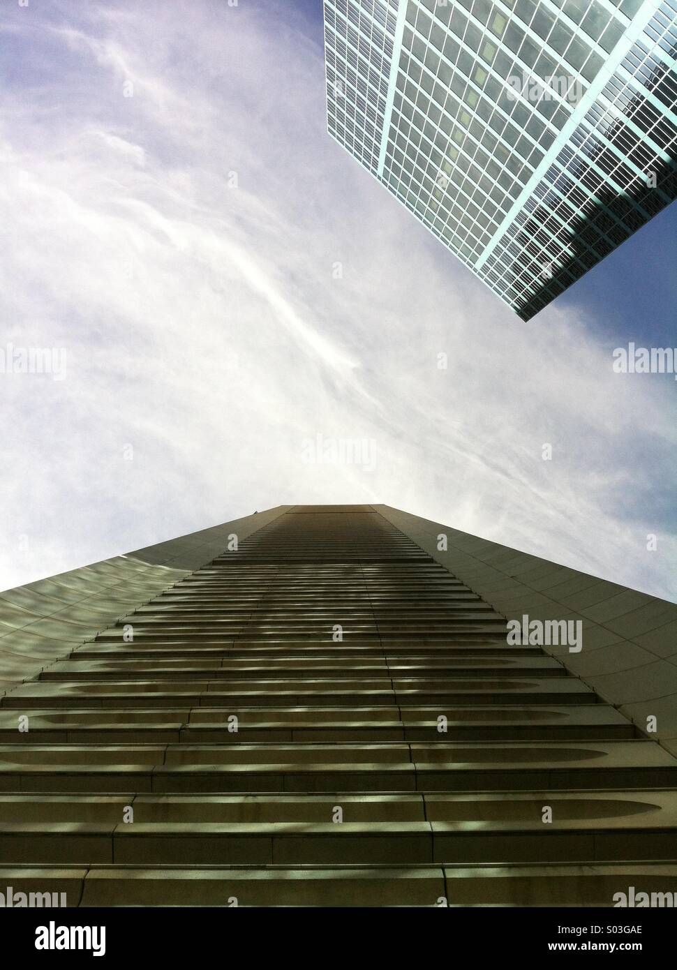 Looking up to the sky at two skyscrapers in Sydney - Stock Image
