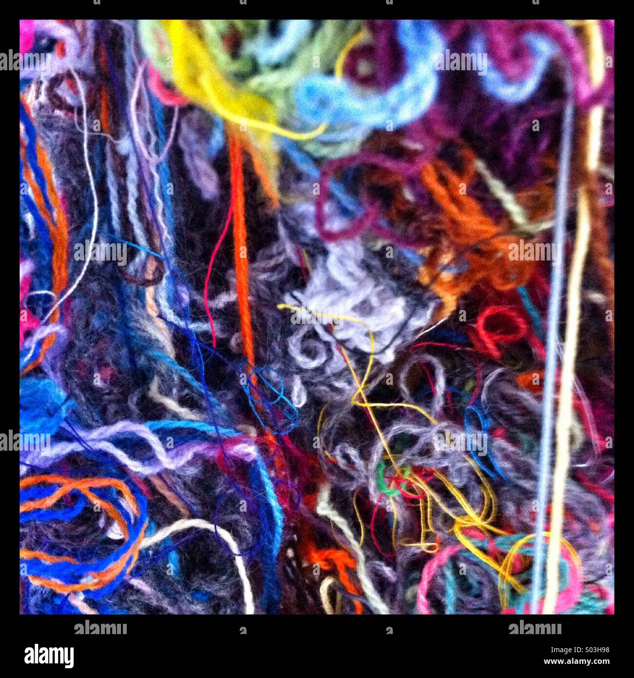 A tangle of wool and threads - Stock Image
