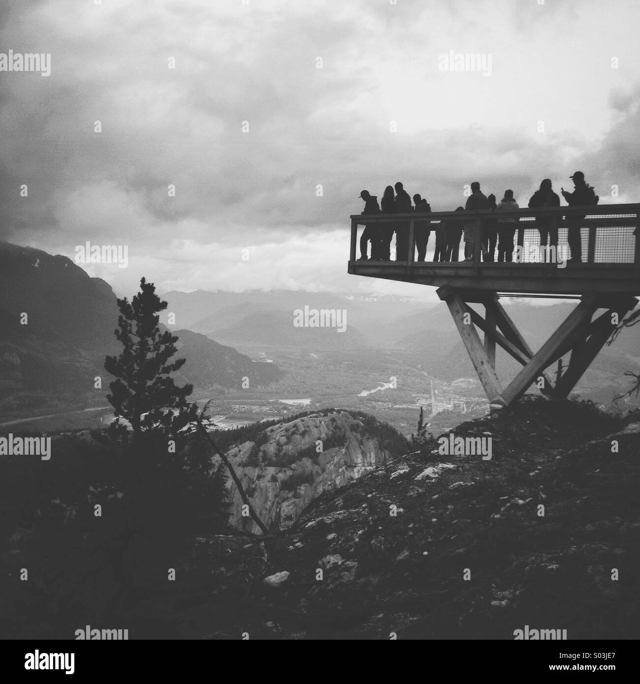 Sightseers looking out over coastal mountains in Squamish, British Columbia - Stock Image