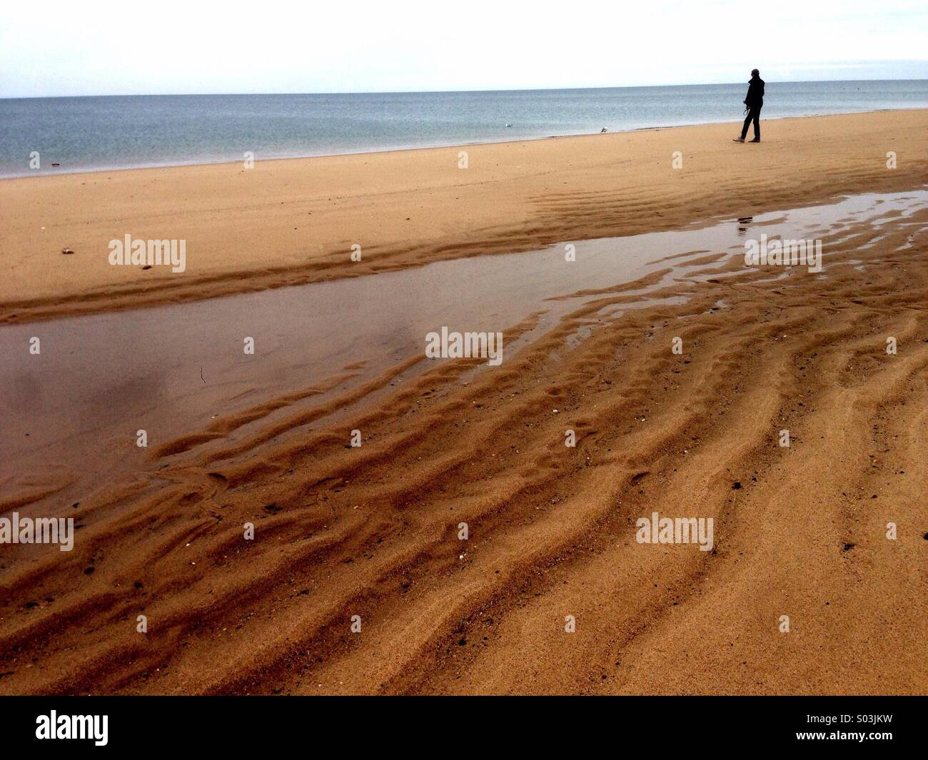 Walking on the beach in cape cod. - Stock Image