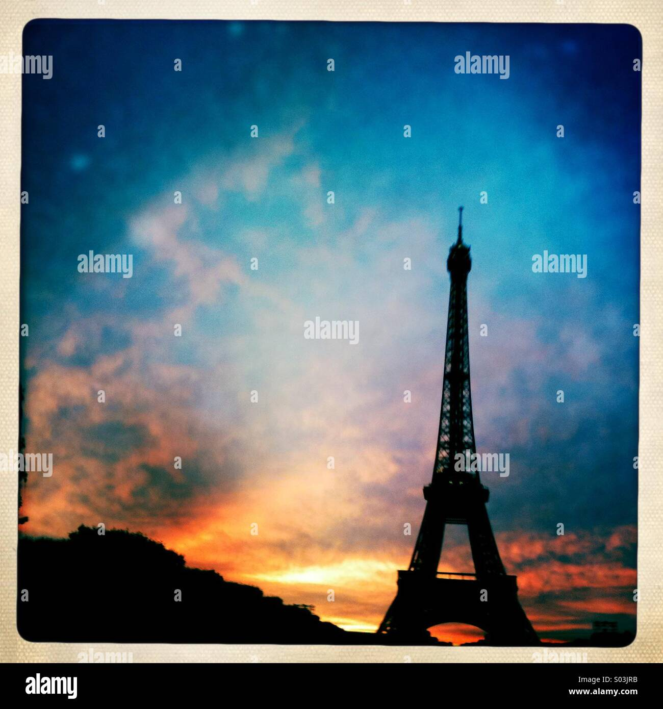 Eiffel Tower at sunset. - Stock Image