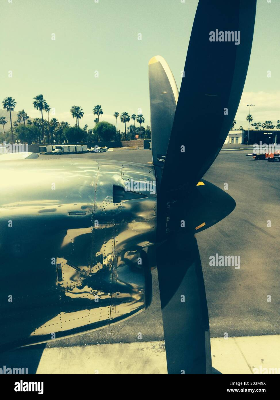Turboprop sits on tarmac  at Palm Springs International airport - Stock Image