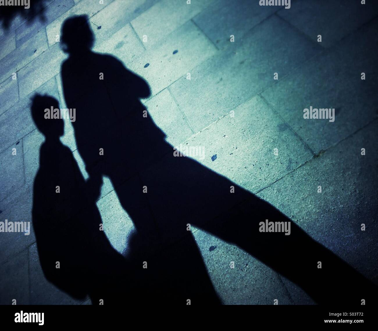 Shadow of a mother and her child walking together on the street in Barcelona Stock Photo