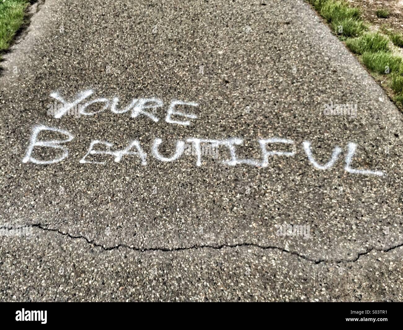 You're Beautiful written on walkway - Stock Image