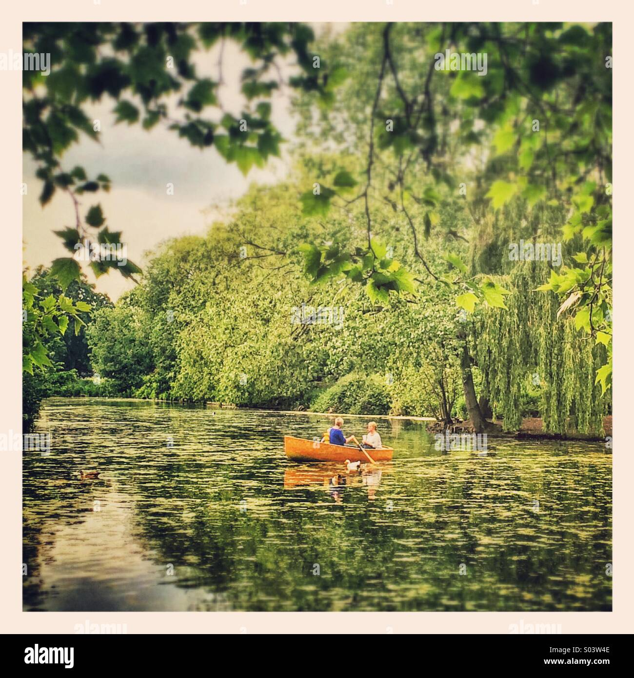 Boating on a lake in Finsbury Park, London - Stock Image