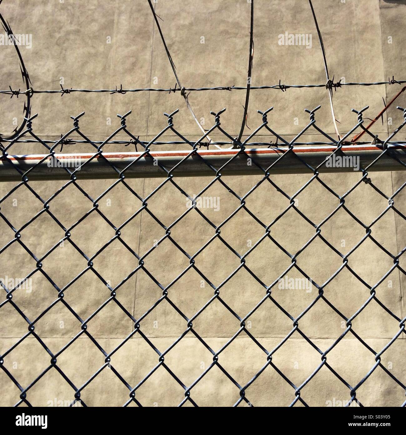 fence and barbed wire - Stock Image