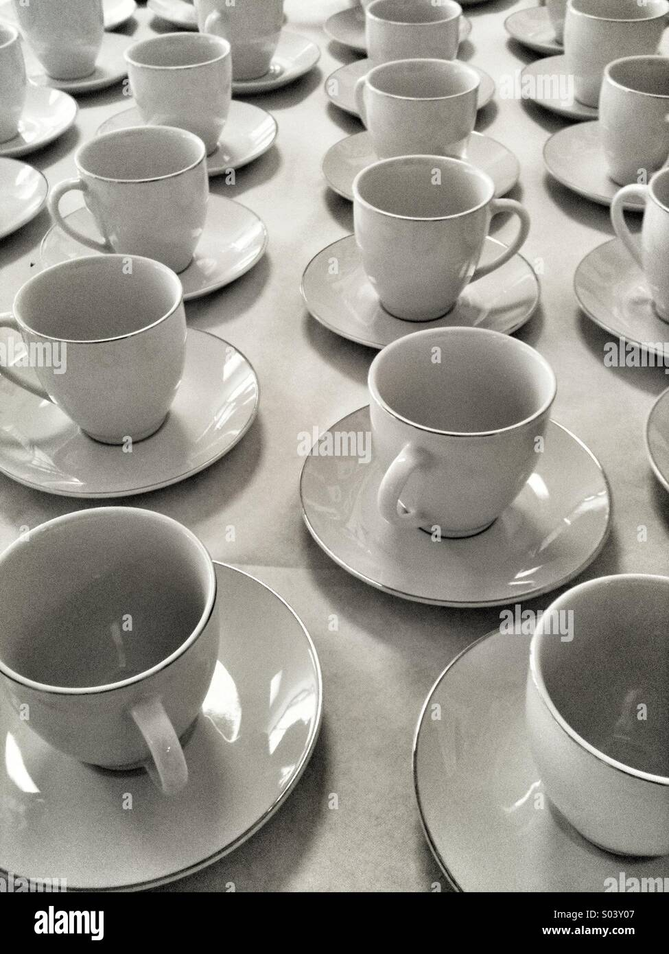 Cups and saucers. - Stock Image
