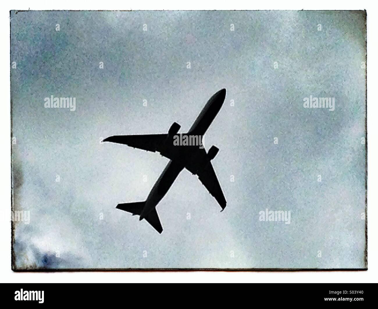 Commercial jetliner in-flight - Stock Image