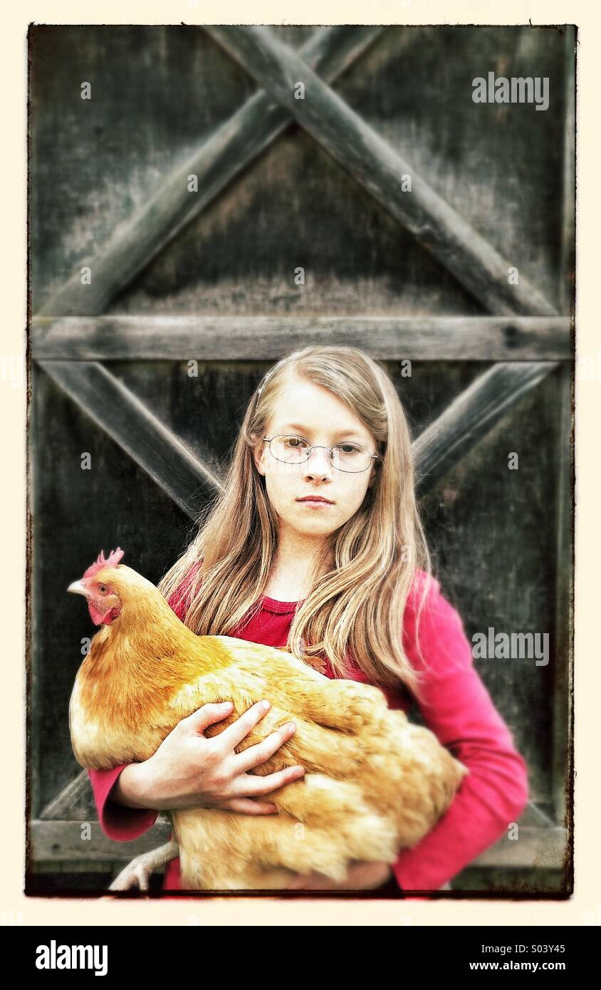Young girl with chicken - Stock Image
