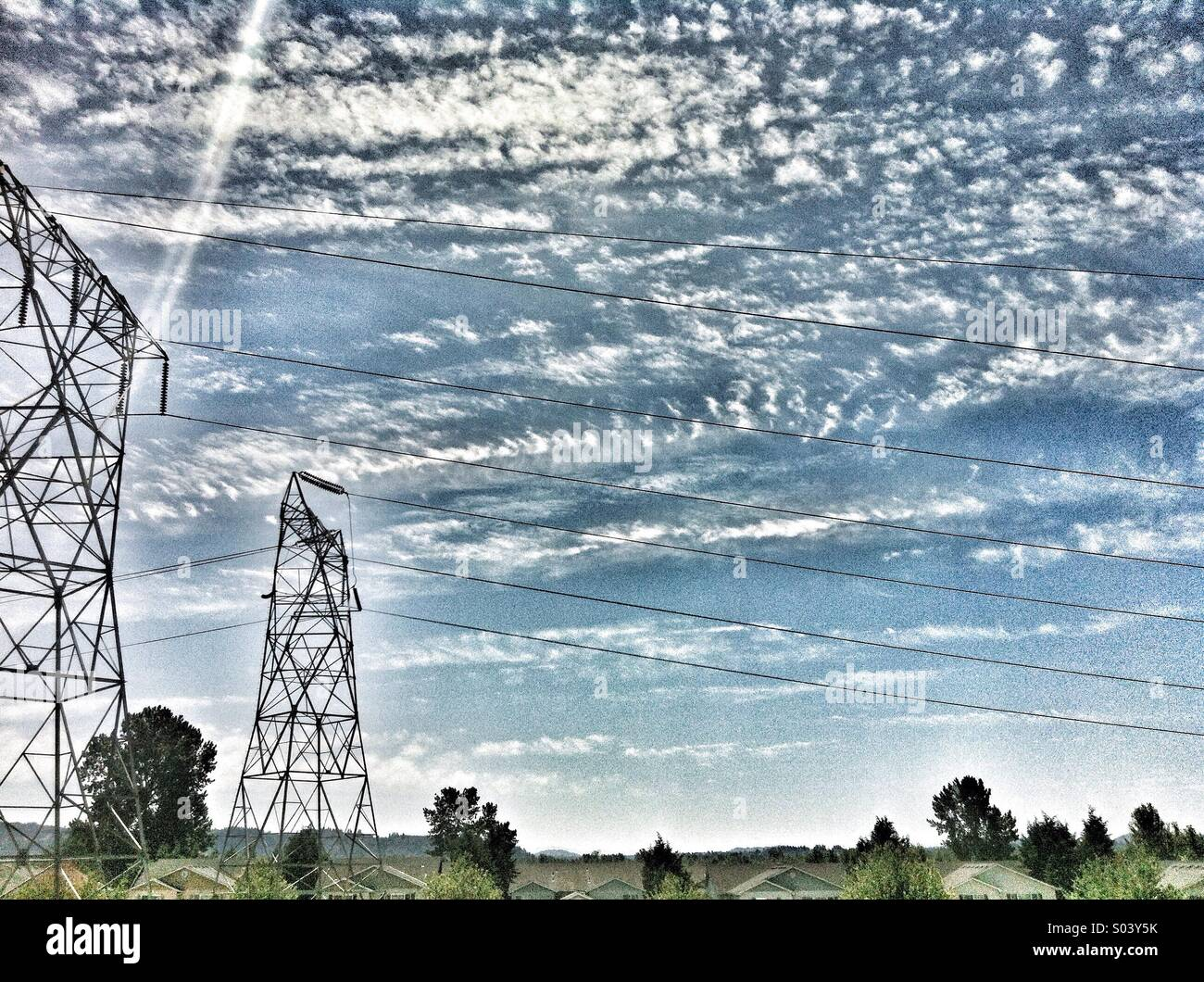 Powerlines with clouds. - Stock Image