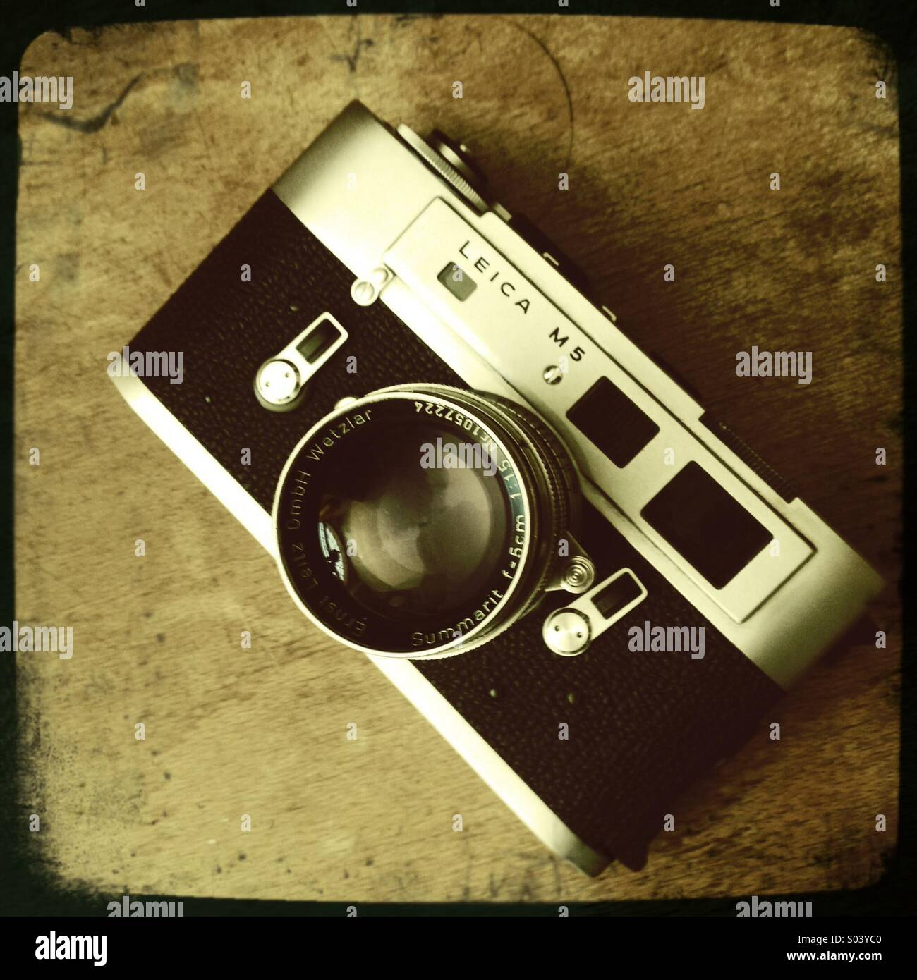 Vintage film camera rangefinder Leica M5 with lens - Stock Image