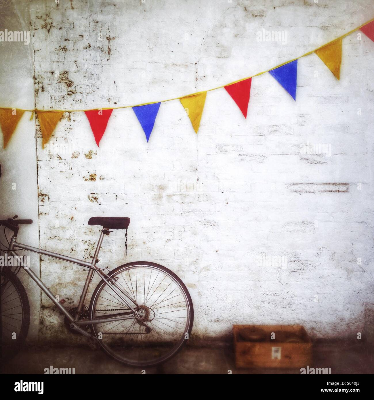 The Bike and the Bunting - Stock Image