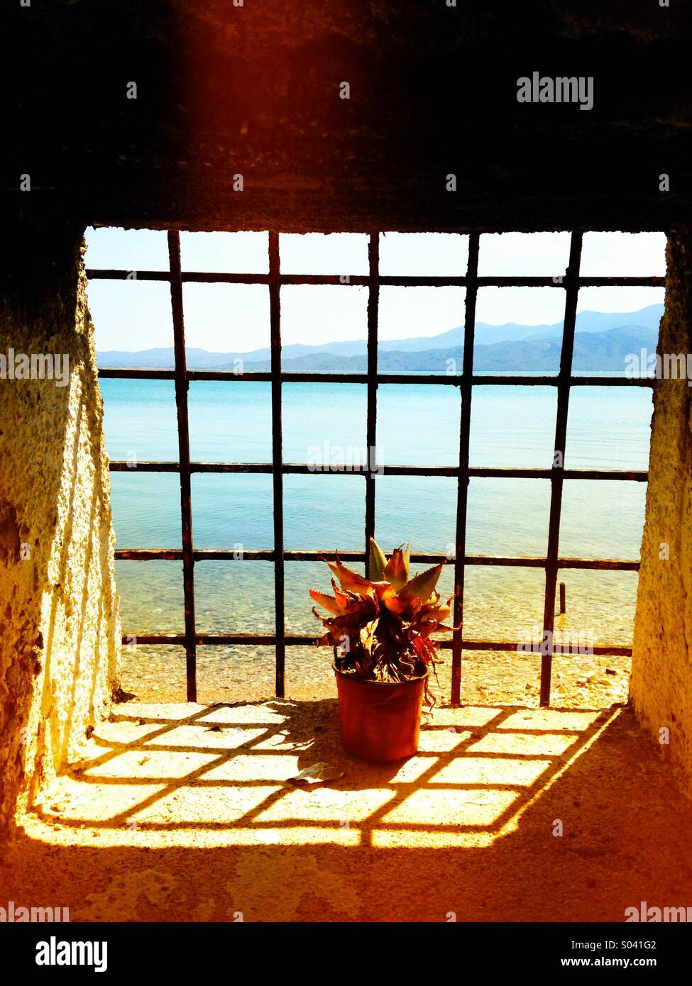 View out the window of a Greek hammam onto the Aegean Sea - Stock Image