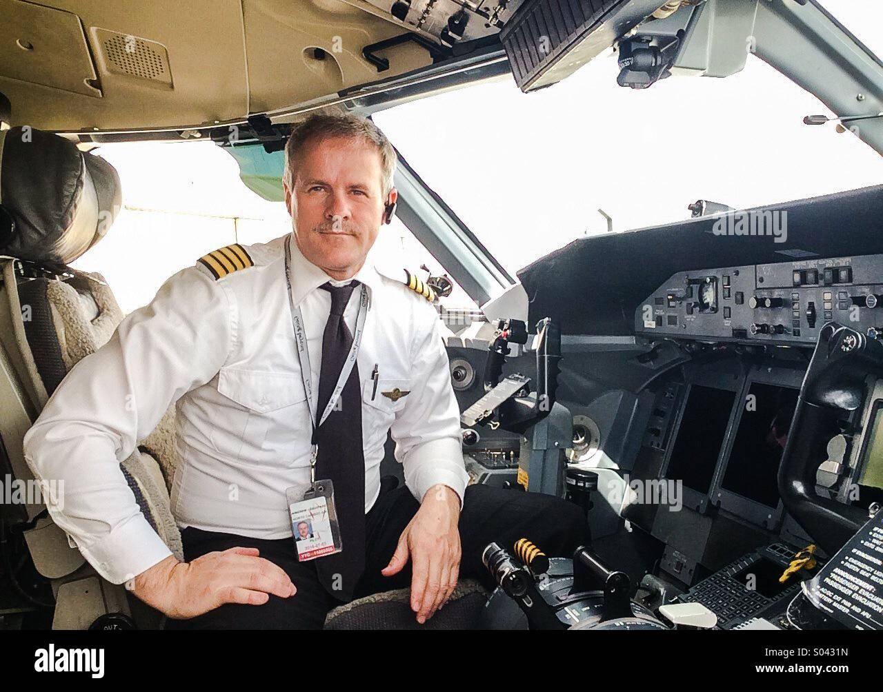 Captain on Dash 8 Q400 - Stock Image
