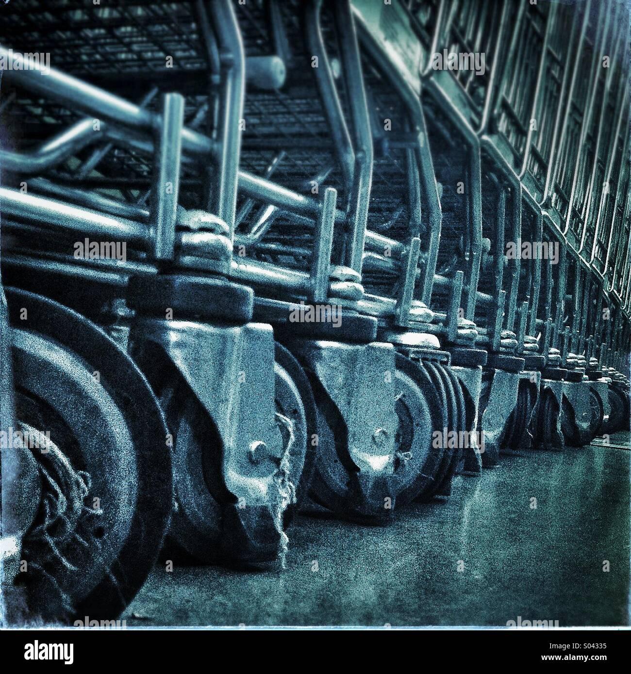 Stacked supermarket shopping carts - Stock Image