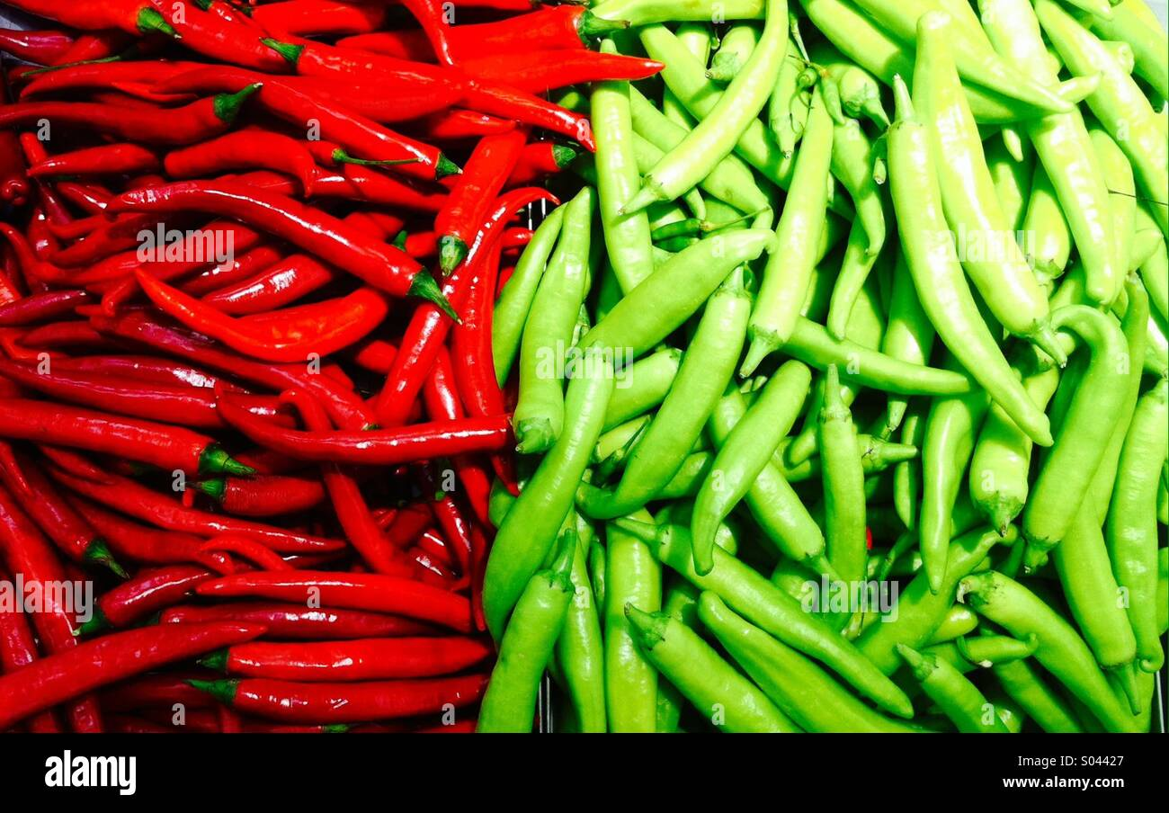 Red andTwo tone of hot chilly  pepper in the market - Stock Image