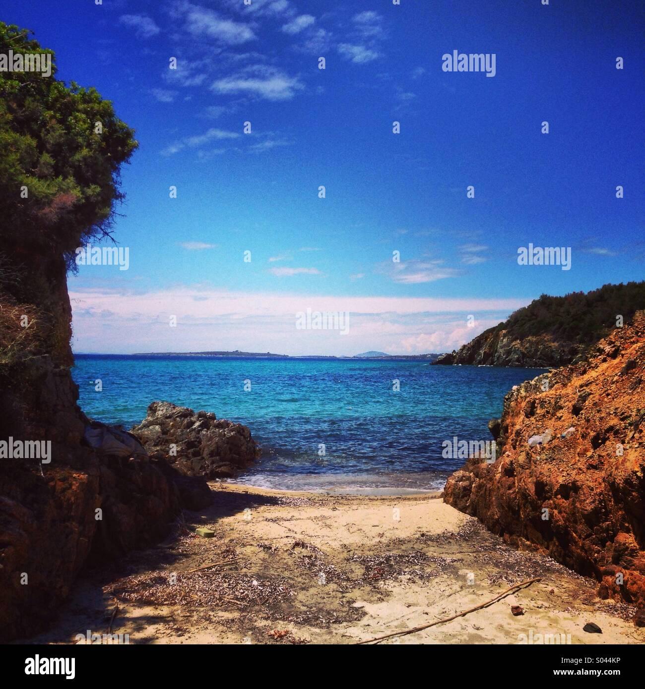Hidden little beach - Stock Image