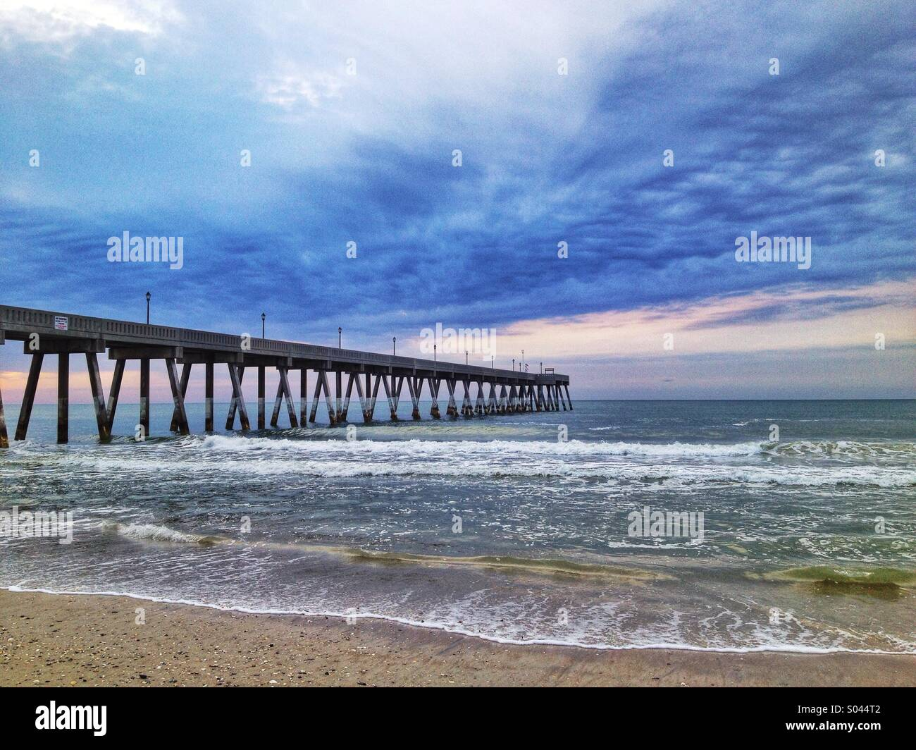 A fishing pier extends out into the Atlantic Ocean Stock Photo
