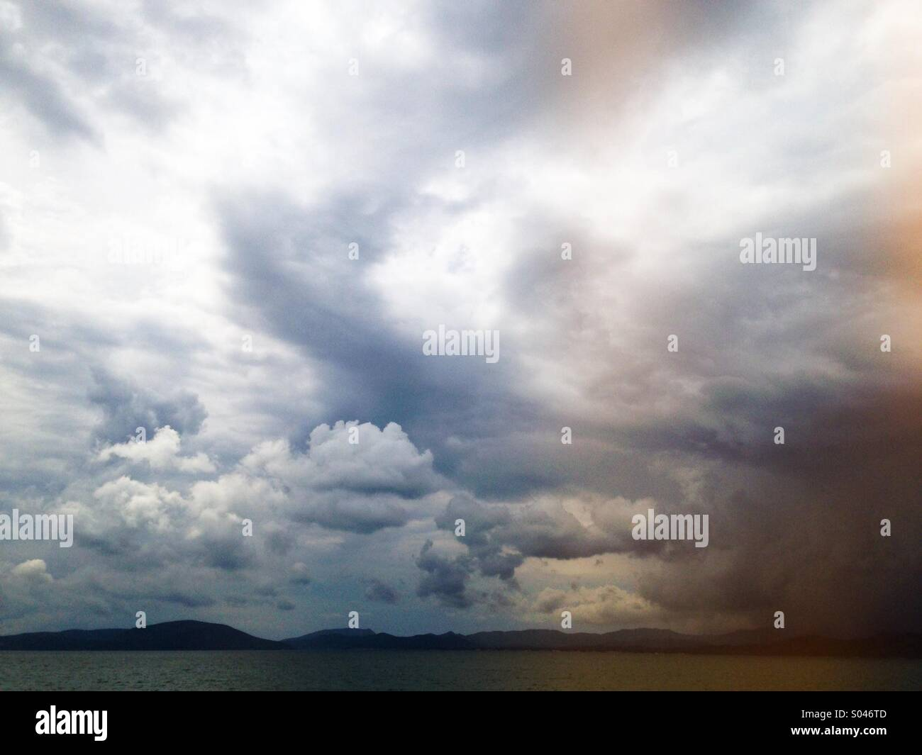 Storm clouds on the horizon - Stock Image