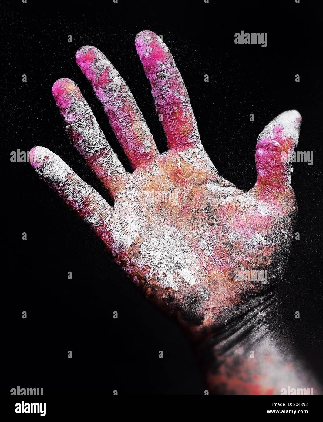 Colorful and dirty hand - Stock Image
