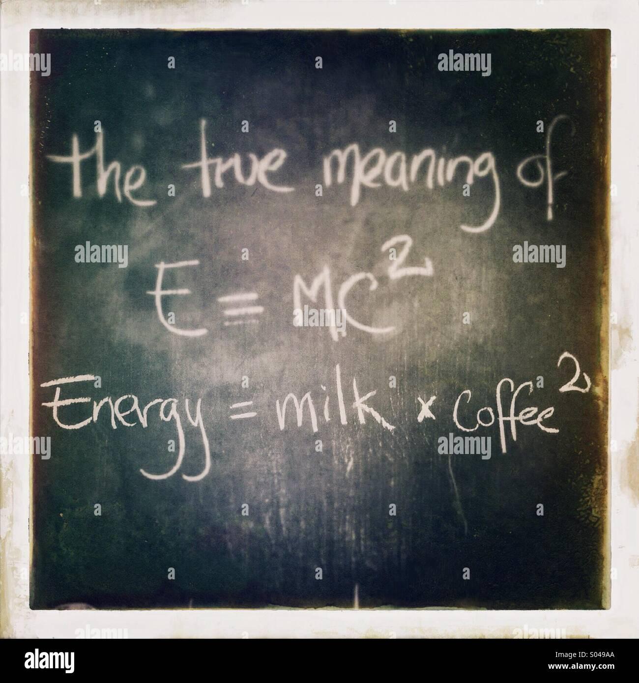 Coffee related wisdom written on a chalkboard outside a coffee shop. - Stock Image